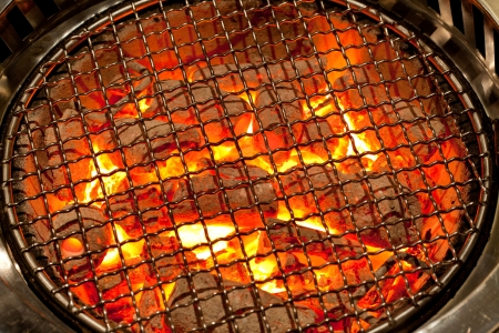 coal fire: fired charcoal with grill plate for korean cuisine preparation