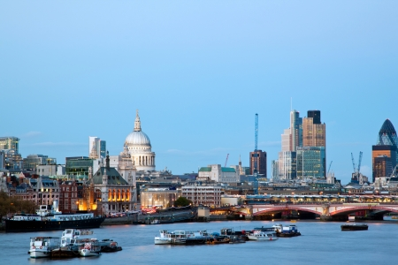 millennium bridge: London Cityscape with St Pauls Cathedral and River Thames England UK at dusk Stock Photo