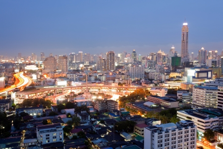 expressway: Citscape of Bangkok Skylines at Victory Monument Downtown at Dusk aerial view Stock Photo