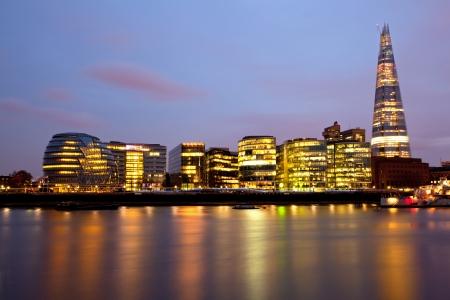 skylines: London City Hall Skylines along River Thames at Dusk, England UK Stock Photo