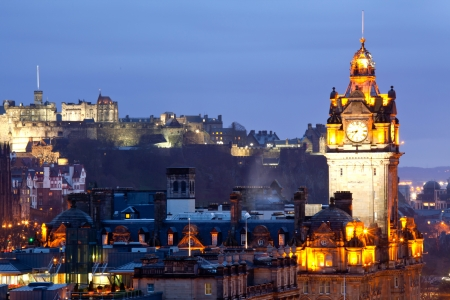 edinburgh: Close up of Edinburgh Castle and Skylines Skyscrapers cityscape and from Calton Hill at dusk Scotland UK Stock Photo