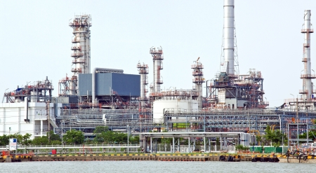landscape of Oil refinery plant along river Panorama photo