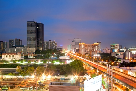 Aerial view of Bangkok Highway and building at downtown area at dusk photo