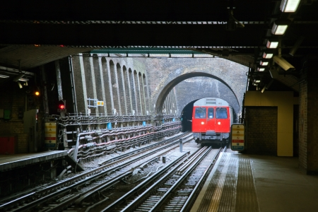 tube station: Red Train coming to Station London England UK
