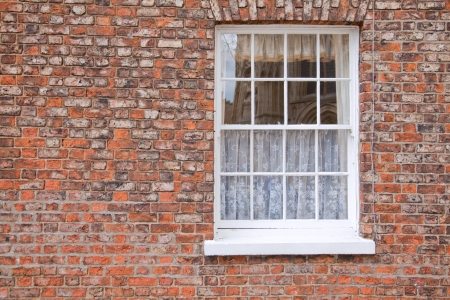 Gothic White Windows on Brickwall photo