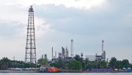 landscape of Oil distillation Tower at refinery plant along river photo