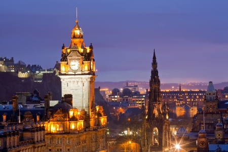 Edinburgh Clock Tower and scott monument from Calton Hill at dusk Scotland UK