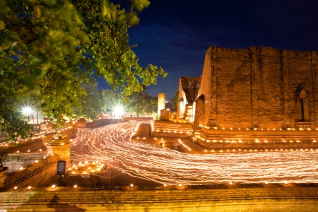 candle light trail of Buddhism Ceremony at temple ruin on Asalha Puja day photo