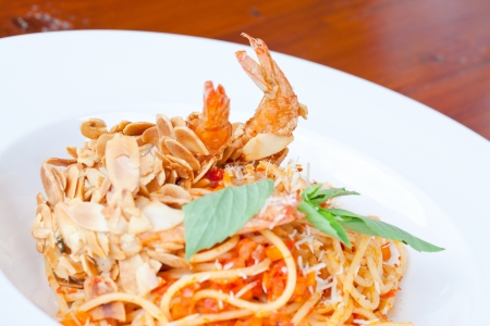Spaghetti with Almond Shrimp meal cuisine (Selective Focus at shrimp) photo