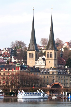 Church with cityscape and lake in Lucern Switzerland photo