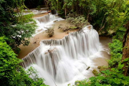 Tropical Rain forest waterfall in National Park in Thailand photo