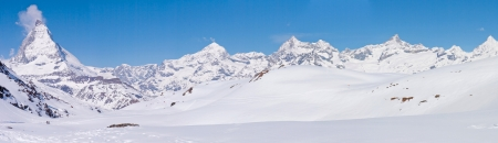 the swiss alps: Panorama of Snow Mountain Range Landscape with Blue Sky at Matterhorn Peak Alps Region Switzerland