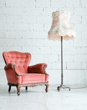 Pink classical style Armchair sofa couch in vintage room with desk lamp Stock Photo