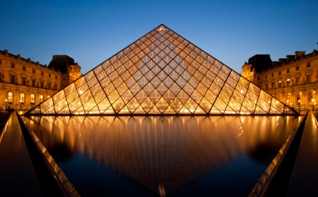 louvre pyramid: PARIS-APRIL 16: Reflection of Louvre pyramid shines at dusk during the Summer Exhibition April 16, 2010 in Paris. Louvre is the biggest Museum in Paris displayed over 60,000 square meters of exhibition space.