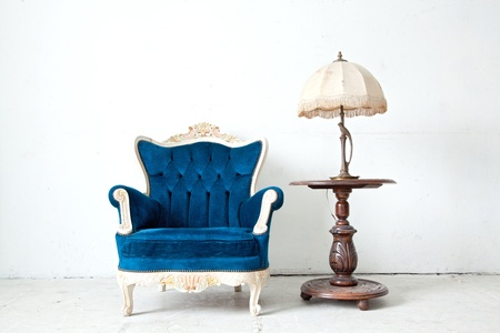 Blue classical style Armchair sofa couch in vintage room with desk lamp photo