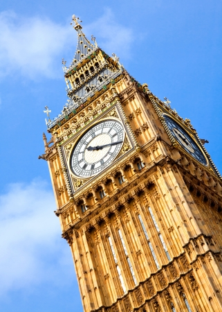 Close up of Big Ben Clock Tower Against Blue Sky England United Kingdom photo