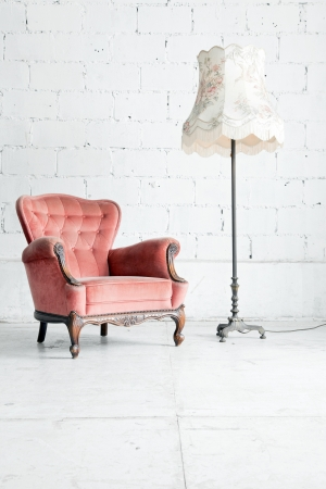 modern sofa: Pink classical style Armchair sofa couch in vintage room with desk lamp Stock Photo