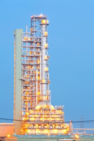 Distillation tower at Oil Refinery Plant at dusk photo