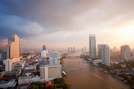 Aerial view of Bangkok Skyline along Chaophraya River sunset