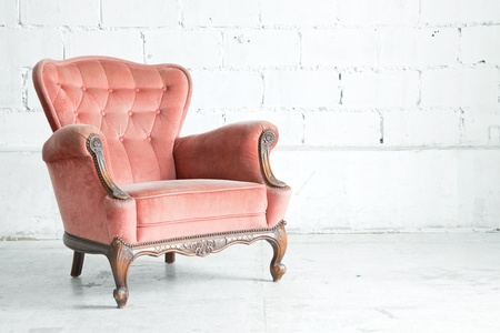 antique chair: Pink classical style Armchair sofa couch in vintage room