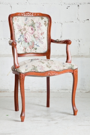 wooden vintage armchair sofa in vintage room photo