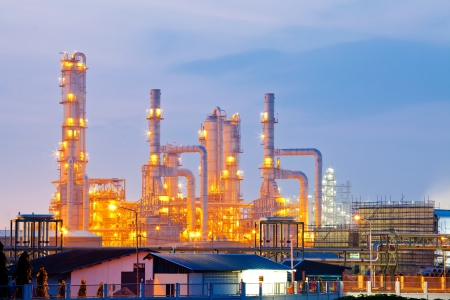petrochemicals: Architecture of Oil Refinery Plant with distillation tower with Sunrise Twilight