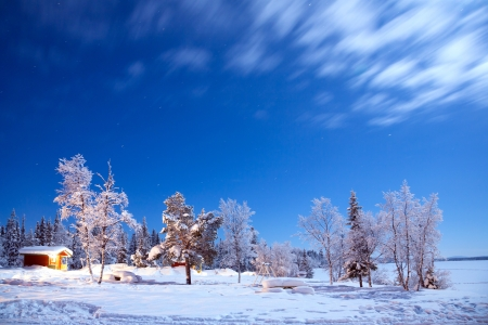 Winter landscape with cabin hut at night in Kiruna Sweden at Night with star trail Stock Photo - 17162632