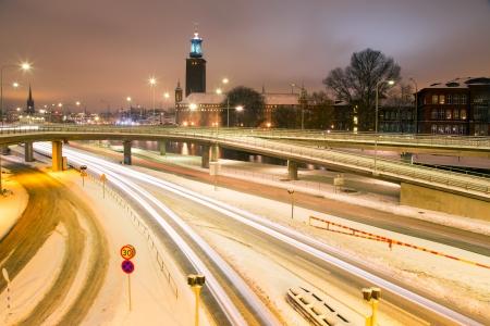 cityhall: Stockholm Cityhall at night with transportation light trail Sweden