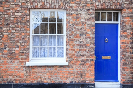 Windows and door on Gothic style Brick house photo