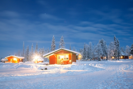 Winter landscape with cabin hut at night in Kiruna Sweden at Night with star trail photo