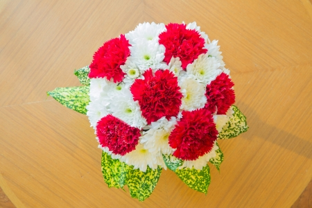 top view red Carnation bouquet using in wedding or any greeting ceremony photo