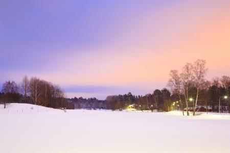 christmas scenic: Winter landscape in Stockholm Sweden at dusk Stock Photo