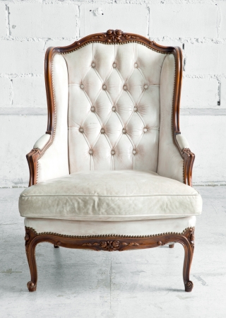 White genuine leather classical style sofa in vintage room photo