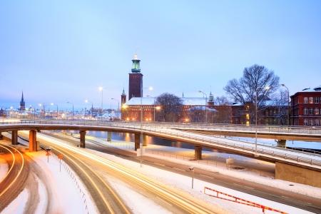 cityhall: Stockholm Cityhall at dusk with transportation light trail Sweden