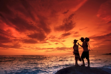 Silhouette romantic Scene of couples on the Beach photo