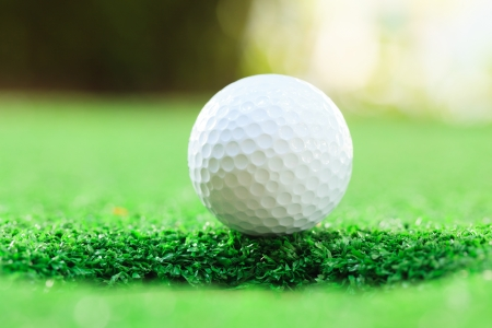 golf ball on lip of cup (Selective focus at golf ball) Stock Photo - 17439199