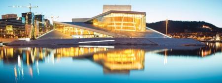 Panorama of Oslo Opera House shine at dusk, morning twilight,  Norway