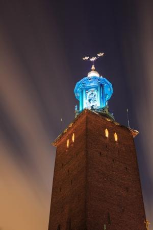 cityhall: Clock Tower of Stockholm Cityhall Studhus Sweden at Night Stock Photo
