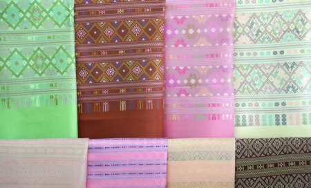 thailand silk: pieces of colorful silk fabric using as background Stock Photo