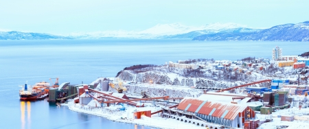 mining ship: Panorama of Industrial Container Cargo freight ship with working crane bridge in shipyard at Iron Ore Mine Factory Plant in Narvik Norway Stock Photo