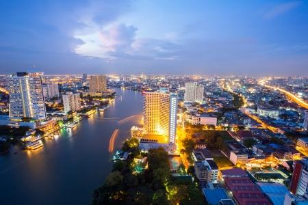 Aerial view of Bangkok Skyline along Chaophraya River at dusk Stock Photo - 17818395