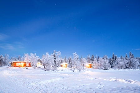 Winter landscape with cabin hut at night in Kiruna Sweden at Night with star trail Stock Photo - 17818388
