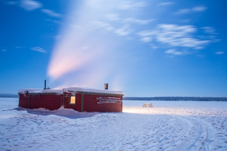 Winter landscape with cabin hut over frozen lake at night in Kiruna Sweden at Night with star trail Stock Photo - 17993463