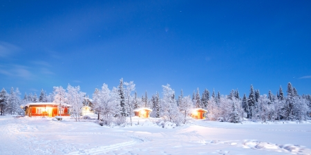 Winter landscape with cabin hut at night in Kiruna Sweden at Night with star trail Stock Photo - 18128785