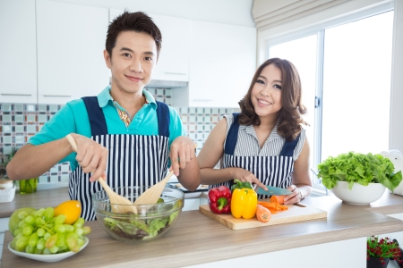 happy asian couple: Young happy couples in domestic kitchen