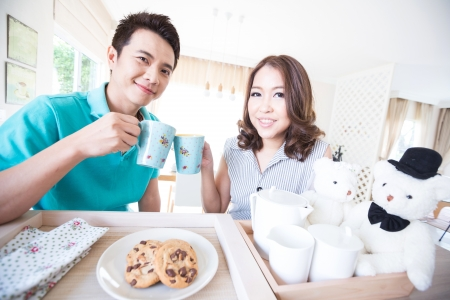 head home: Young happy couples in domestic kitchen with breakfast