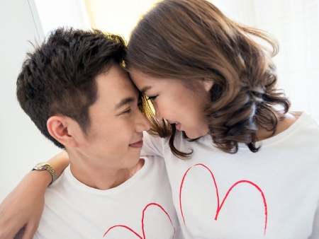 Happy Young Couples in love kissing photo