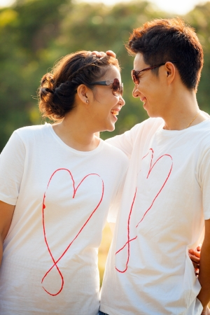feels: Happy Young Adult Couples in love outdoor Stock Photo