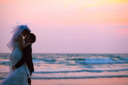 happiness and romantic Scene of love couples partners wedding on the Beach photo