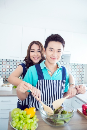 Young happy couples in domestic kitchen
